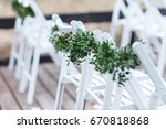 white chairs decorated with... | Shutterstock . vector #670818868