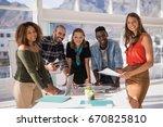 portrait of happy colleagues... | Shutterstock . vector #670825810