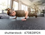 asian men doing push ups in gym | Shutterstock . vector #670828924
