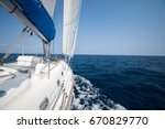 sailing boat moves in the open... | Shutterstock . vector #670829770