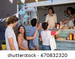 smiling waitress giving juice... | Shutterstock . vector #670832320