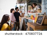 smiling waiter taking order... | Shutterstock . vector #670837726