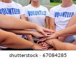 volunteer group hands together... | Shutterstock . vector #67084285