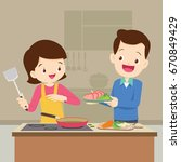man and woman in the kitchen...   Shutterstock .eps vector #670849429