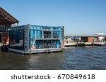 floating bar docked at... | Shutterstock . vector #670849618