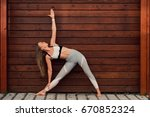 woman doing yoga outdoors.... | Shutterstock . vector #670852324
