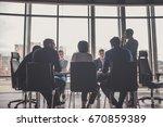 business people meeting... | Shutterstock . vector #670859389