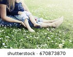 mother and baby feet on grass | Shutterstock . vector #670873870