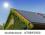 solar panels on a roof with... | Shutterstock . vector #670892503