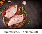 raw chicken fillets with... | Shutterstock . vector #670896088