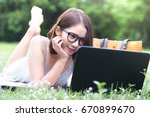smiling girl with glasses lying ... | Shutterstock . vector #670899670