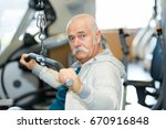 fit senior man working out at... | Shutterstock . vector #670916848