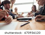 businesspeople discussing... | Shutterstock . vector #670936120