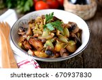 Small photo of Stewed potatoes with mushrooms, onions, cabbage and garlic with olive oil.