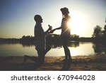 will you marry me  silhouette... | Shutterstock . vector #670944028