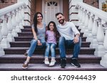 happy family is sitting on... | Shutterstock . vector #670944439