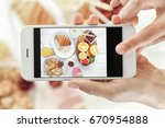 female hands taking pictures of ... | Shutterstock . vector #670954888