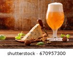 blue cheese appetizer and beer... | Shutterstock . vector #670957300