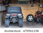 atv quadbike parked at the... | Shutterstock . vector #670961158