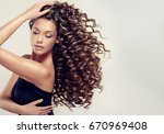 brunette  girl with long  and   ... | Shutterstock . vector #670969408