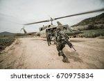u.s. navy eods fast ropes down... | Shutterstock . vector #670975834