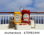 condiments on white table on... | Shutterstock . vector #670981444