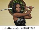 young woman with a samurai... | Shutterstock . vector #670983970