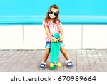 fashion child stands with... | Shutterstock . vector #670989664