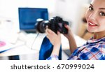 female photographer sitting on... | Shutterstock . vector #670999024