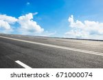 asphalt road and sky cloud... | Shutterstock . vector #671000074