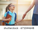 parent and pupil of primary... | Shutterstock . vector #671044648