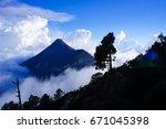 hiking fuego and acatenago... | Shutterstock . vector #671045398