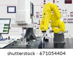automated robotic picking... | Shutterstock . vector #671054404