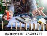 businesswoman domino picked up... | Shutterstock . vector #671056174