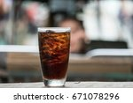 cola in glass background blur | Shutterstock . vector #671078296