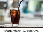cola in glass background blur | Shutterstock . vector #671080996