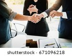 Small photo of Real estate agents agree to buy a home and give keys to clients at their agency's offices. Concept agreement