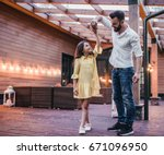 dad is dancing with his... | Shutterstock . vector #671096950