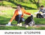 young beautiful volunteer... | Shutterstock . vector #671096998