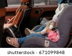 year old baby buckled into her... | Shutterstock . vector #671099848
