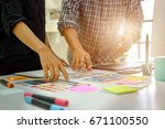 team of designers working at... | Shutterstock . vector #671100550