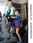 dad and son training in gym | Shutterstock . vector #671124904