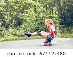 young girl roller skating down... | Shutterstock . vector #671125480