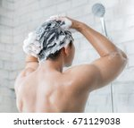 the man is washing his hair  he ... | Shutterstock . vector #671129038