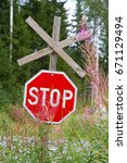 red road sign stop in a summer... | Shutterstock . vector #671129494