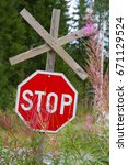 red road sign stop in a summer... | Shutterstock . vector #671129524