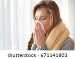 young ill woman with tissue at... | Shutterstock . vector #671141803