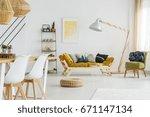 round wicker footrest lying on... | Shutterstock . vector #671147134