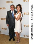 Small photo of President and Chief Executive Officer of CBS Corporation Les Moonves (L) and wife Julie Chen attend the 2015 CBS Upfront at The Tent at Lincoln Center on May 13, 2015 in New York City.