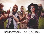 group of friends holding... | Shutterstock . vector #671162458